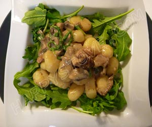 Gnocchi with Speck Prosciutto, Arugula, Mushrooms and Bechamel Sauce